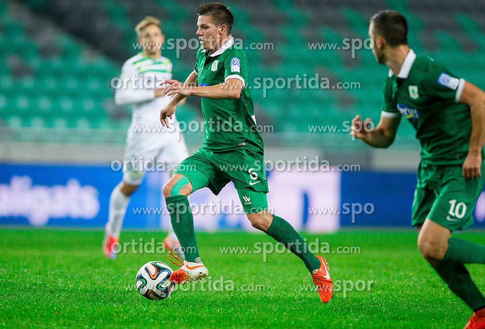 Miha Zajc #6 of Olimpija during football match between NK Olimpija and NK Zavrc in 8th Round of Prva liga Telekom Slovenije 2014/15, on September 13, 2014 in SRC Stozice, Ljubljana, Slovenia. Photo by Vid Ponikvar  / Sportida.com