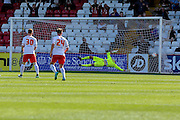 York City defender Eddie Nolan shot evades Stevenage Goalkeeper on loan from Fulham Jesse Joronen for York City to take the lead  during the Sky Bet League 2 match between Stevenage and York City at the Lamex Stadium, Stevenage, England on 12 September 2015. Photo by Simon Davies.