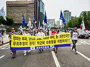 09 JUNE 2018 - SEOUL, SOUTH KOREA: People march through central Seoul during a pro-American rally in downtown Seoul. Participants said they wanted to thank the US for supporting South Korea and they hope the US will continue to support South Korea. Many were also opposed to ongoing negotiations with North Korea because they don't think Kim Jong-un can be trusted to denuclearize or to not attack South Korea.     PHOTO BY JACK KURTZ