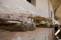 Wooden supports hold together masonry of a balcony in the Balcony House ruins, Mesa Verde National Park, near Cortez, Colorado.
