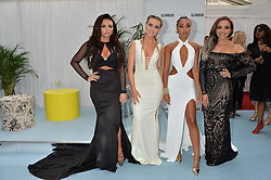 Left to right, JESY NELSON, PERRIE EDWARDS, LEIGH-ANNE PINNOCK and JADE THIRLWALL of Little Mix at the Glamour Magazine Women of the Year Awards in association with Next held in the Berkeley Square Gardens, London on 7th June 2016.