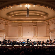 """March 27, 2012 - New York, NY : Music Director and Conductor Michael Tilson Thomas, on podium, leads the San Francisco Symphony, featuring the St. Lawrence String Quartet, in the New York premiere of John Adams's """"Absolute Jest"""" in Carnegie Hall's Stern Auditorium on Tuesday evening.  CREDIT : Karsten Moran for The New York Times"""
