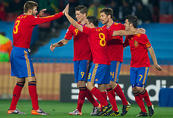 Gerard Pique, Fernando Torres, Xavi, Carlos Marchena and David Villa of Spain celebrate during the 2010 FIFA World Cup South Africa Group H Second Round match between Spain and Honduras on June 21, 2010 at Ellis Park Stadium, Johannesburg, South Africa.   (Photo by Vid Ponikvar / Sportida)