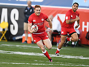 Canada player Connor Braid gains ground from the kickoff in the game Canada vs England during the USA Sevens Rugby Series at Sam Boyd Stadium, Las Vegas, USA on 2 March 2018. Picture by Ian  Muir.