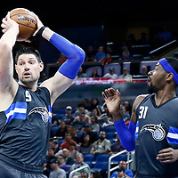 25 February 2017: Orlando Magic center Nikola Vucevic (9) grabs a rebound next to Orlando Magic forward Terrence Ross (31) during the Orlando Magic 105-86 victory over the Atlanta Hawks, at the Amway Center, Orlando, Florida, USA.
