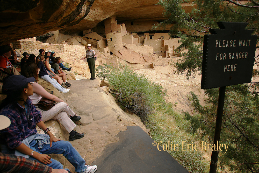 Tourists listen as a park ranger talks about the history of the Cliff Palace before a walking tour of the dwelling. From approximately A.D. 600 through A.D. 1300 a native american culture flourished in communities throughout the area.