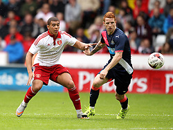Sheffield United's Che Adams and Newcastle United's  Jack Colback - Mandatory by-line: Robbie Stephenson/JMP - 26/07/2015 - SPORT - FOOTBALL - Sheffield,England - Bramall Lane - Sheffield United v Newcastle United - Pre-Season Friendly