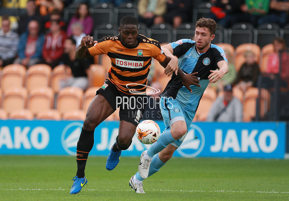 John Akinde and Dan Rowe tussle for possession during the Sky Bet League 2 match between Barnet and Wycombe Wanderers at Underhill Stadium, London, England on 15 August 2015. Photo by Bennett Dean.