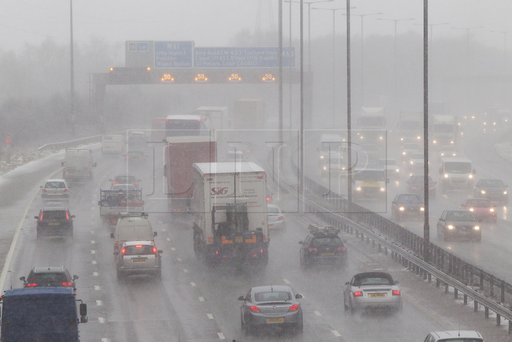 © Licensed to London News Pictures . 05/02/2013 . Manchester , UK . Heavy snow , fog and high winds are causing traffic delays and accidents on the M60 motorway (pictured) in and around Manchester . Photo credit : Joel Goodman/LNP
