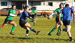 Westport's Lyndon Jones passes to Danny O' Toole during the junior league match against Ballina...Pic Conor McKeown