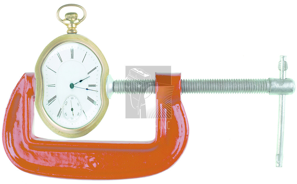 Clamp squeezing a clock on white