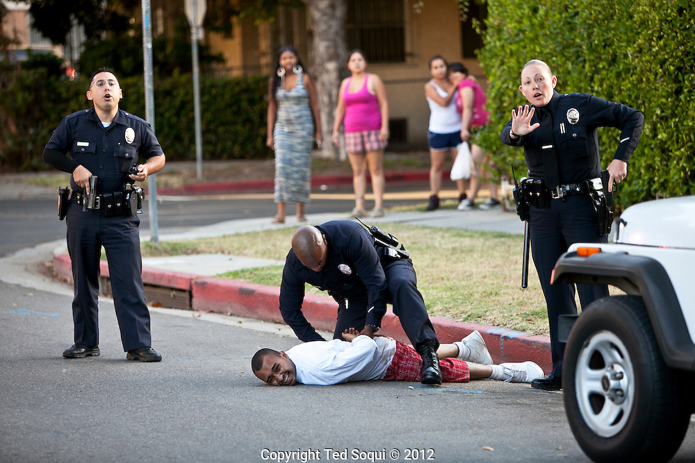 Shooting at a kids baseball game. Queen Anne Park in the mid-city area of LA. 3 people were shot.Shooting at Queen Anne Park in the mid-city area of Los Angeles. 3 people were shot during a children's baseball game in the late afternoon. The gun man escaped.Shooting at Queen Anne Park in the mid-city area of Los Angeles. 3 people were shot during a children's baseball game in the late afternoon. The gun man escaped..LAPD says the shooting was gang related.