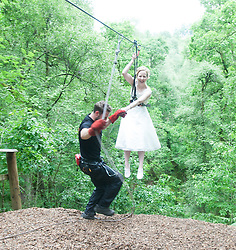 Martin Milner and Colette Gregory tying the knot in the trees at Go Ape Aberfoyle. Colette arriving on the first zip wire.