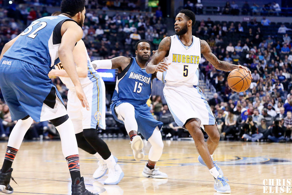 15 February 2017: Denver Nuggets guard Will Barton (5) drives past Denver Nuggets forward Nikola Jokic (15) during the Minnesota Timberwolves 112-99 victory over the Denver Nuggets, at the Pepsi Center, Denver, Colorado, USA.