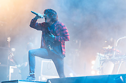 © Licensed to London News Pictures. 29/08/2015. Reading Festival, UK.  Bring Me the Horizon performing at Reading Festival 2015, Day 2.  In this picture - Oliver Sykes.  Photo credit: Richard Isaac/LNP