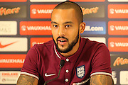 England forward Theo Walcott talks to the media during the England press conference at St George's Park National Football Centre, Burton-Upon-Trent, United Kingdom on 7 October 2015. Photo by Aaron Lupton.