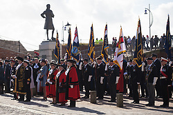 © Licensed to London News Pictures. 16/10/2016. Portsmouth, Hampshire, UK. People gathered as part of the laying of wreaths at the statue of Lord Nelson in the annual service for seafarers. Lord-Lieutenant of Hampshire, NIGEL ATKINSON and Lord Mayor of Portsmouth, Councillor DAVID FULLER, have taken part in the annual Seafarer's Service held at Portsmouth Cathedral, and the laying of wreaths at the statue of Lord Nelson. The service is held annually, on the first Sunday prior to the anniversary of the Battle of Trafalgar, 21st October, and remembers those who have lost their lives at sea, and also commemorates the life of Lord Horatio Nelson. Photo credit: Rob Arnold/LNP