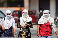 April 17, 2018 - Allahabad, Uttar Pradesh, India - Girls cover their face with clothe to being safe with scorching heat on a hot day in Allahabad on 17-04-2018 (Credit Image: © Prabhat Kumar Verma via ZUMA Wire)