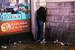 © Licensed to London News Pictures. 01/01/2016. London, UK. A reveller urinating in Piccadilly Circus whilst celebrating the New Year in central London at the first hours of 2016 on January 1, 2016. Photo credit: Tolga Akmen/LNP