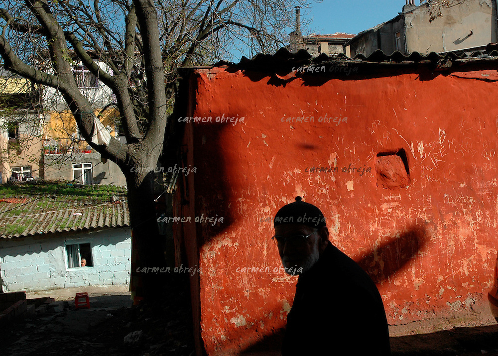 old man walks on a street in Balat district