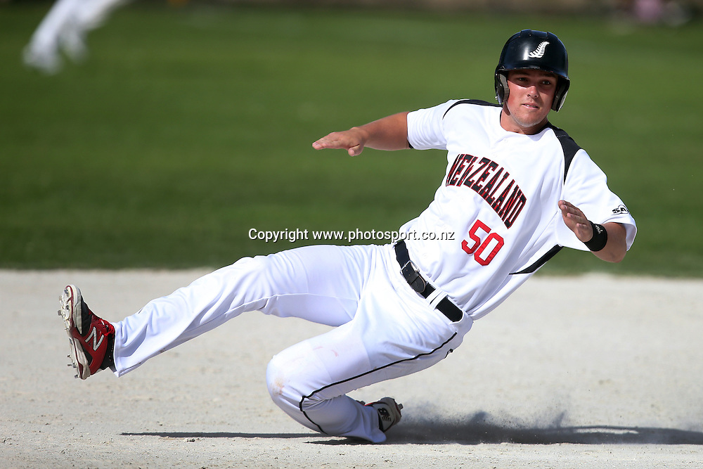 Conner Peden of the Black Sox slides into second base during game three of the Trans Tasman Softball Series between the New Zealand Black Sox and the Australian Steelers at Tradestaff Rosedale Park in Albany, Auckland on 29 March 2014. Photo: Jason Oxenham / www.photosport.co.nz