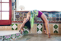 Colorfully dressed yogini in a mosaic house.