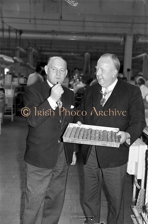 17/04/1963<br /> 04/17/1963<br /> 17 April 1963<br /> Lord Mayor of Birmingham visits Fry-Cadbury factory, Colock, Malahide Road, Dublin. Image shows the Lord Mayor of Birmingham, the Rt. Hon. Ernest Horton (left) sampling a Milk Tray offered by the Lord Mayor of Dublin, Alderman J.J. O'Keeffe.