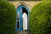UNITED KINGDOM, London: 09 May 2020 <br /> Team Rector and Vicar of St Mary's Church in Barnes  Revd James Hutchings opens the doors of his church to pre-record his Sunday service - the first service from inside the church (as opposed to his home) since the lockdown began. As of this week, clergy are now allowed to enter their churches to pray and stream/record services as part of the first of three stages to the re-opening of churches.