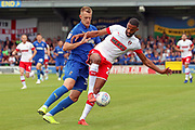 AFC Wimbledon striker Joe Pigott (39) battles for possession with Rotherham United defender Michael Ihiekwe (20) during the EFL Sky Bet League 1 match between AFC Wimbledon and Rotherham United at the Cherry Red Records Stadium, Kingston, England on 3 August 2019.