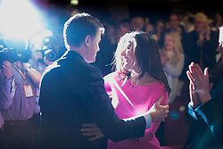 © Licensed to London News Pictures . 15/03/2015 . Liverpool , UK . Nick Clegg and his wife Mirian Gonzalez Durantez embrace after Nick Clegg's speech . The Liberal Democrat Party Conference at the Arena and Conference Centre in Liverpool . Photo credit : Joel Goodman/LNP