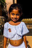 Young girl, Isurumuniya Temple, Anuadhapura. SrI Lanka. Anuradhapura is one of the ancient capitals of Sri Lanka, famous for its well-preserved ruins of an ancient Sri Lankan civilization.