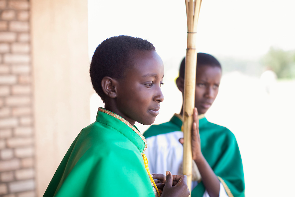 Altar servers Marie Claire Radukunda (left) and Marie Louise Umubyeyi (right) prepare for the start of mass at The Shrine of Our Lady of Sorrows in Kibeho, Rwanda. This is the only sanctioned Marian sanctuary in Africa. Kibeho's overseers and the Rwandan government hope this place will become a top tourism site. <br /> <br /> Photographed, Sunday, October 26, 2014.<br /> <br /> Photo by Laura Elizabeth Pohl