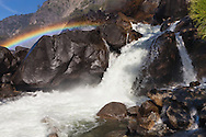 The spray from Wapama Falls creates a rainbow as it rushes into the Hetch Hetchy Reservoir, Yosemite National Park