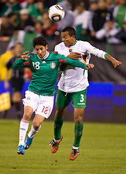 February 24, 2010; San Francisco, CA, USA;  Mexico forward Angel Eduardo Reyna (18) and Bolivia defender Edemir Rodriguez (3) battle for a head ball during the second half at Candlestick Park. Mexico defeated Bolivia 5-0.