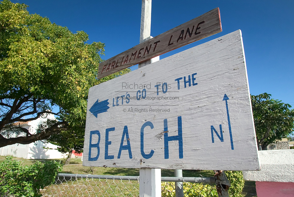 Sign to the beach along the King's Highway in Alice Town on the tiny Caribbean island of Bimini, Bahamas