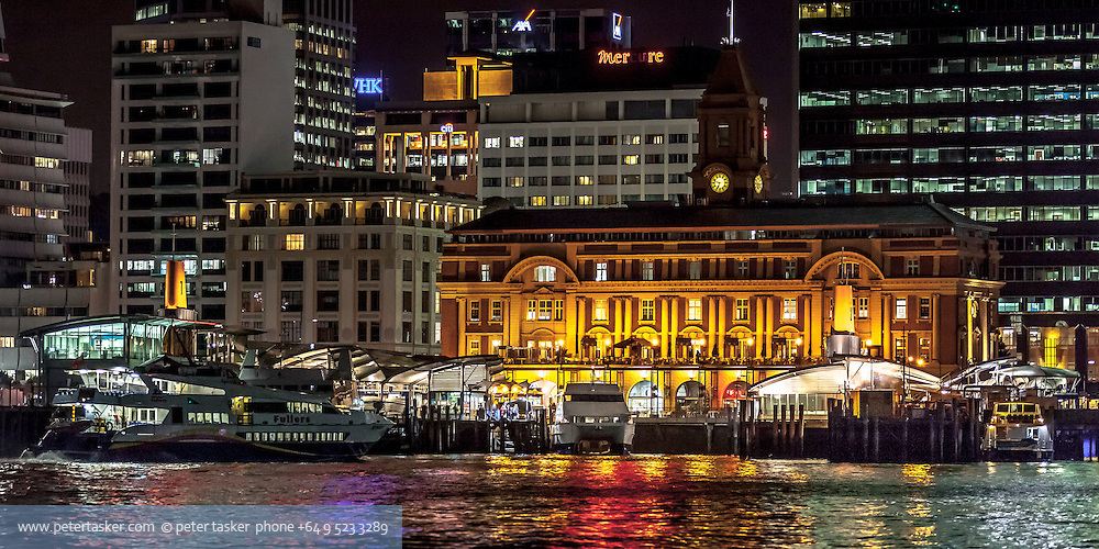 Auckland downtown ferry terminal at night.