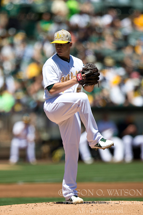 OAKLAND, CA - MAY 26:  Tommy Milone #57 of the Oakland Athletics pitches against the Detroit Tigers during the first inning at O.co Coliseum on May 26, 2014 in Oakland, California. The Oakland Athletics defeated the Detroit Tigers 10-0.  (Photo by Jason O. Watson/Getty Images) *** Local Caption *** Tommy Milone
