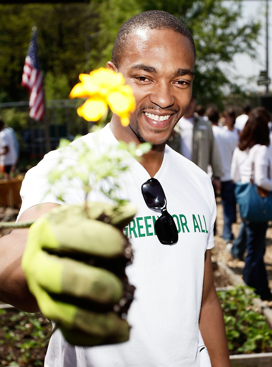 "NEW YORK - APRIL 22:  Actor Anthony Mackie participates in the Green For All Earth Day ""Dig In"" at Riverside Valley Community Garden on April 22, 2010 in the West Harlem neighborhood of  New York City.  (Photo by Joe Kohen/WireImage for Green For All)"