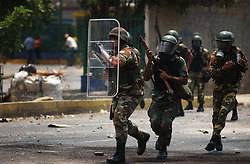 The National Guard fires tear gas and  rubber bullets  at anti-government protestors as riots continued in Caracas between the two groups. The country is awaiting a preliminary decision on the validity of signatures seeking a recall referendum.  It is expected that hundreds of thousands of signatures will have to go to a review process that the opposition will refuse to submit to.