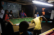 Mbuyuni Pool Club, street children play pool for entertainment, they often gamble their earnings made from a day as a porter in the bus station. There are currently 1416 street children in Moshi, and the numbers are increasing. They are deprived of family care and protection, and are often subject to abuse. Mkombozi work with street children in Moshi, providing; shelter, education, counselling and provisions.