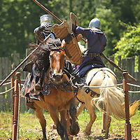 Gino Zoppe, left, portraying Sir Godwin of England, and Timi Loyal, portraying Sir Guiseppe of Italy, battled it out in the jousting competition at the Highland Renaissance Festival in Eminence, Ky., on 6/19/10. The jousting tournament was performed by the Cavalo Equestrian Arts troupe out of Florida. Photo by David Stephenson