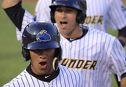 May 19, 2017 - Trenton, New Jersey, U.S - GLEYBER TORRES (foreground), an infielder for the Trenton Thunder, is congratulated by teammates when returning to the dugout following his third-inning grand slam versus the Portland Sea Dogs at ARM & HAMMER Park. (Credit Image: © Staton Rabin via ZUMA Wire)