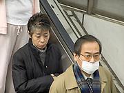 people standing on an escalator