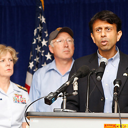 Louisiana Governor Bobby Jindal (right) speaks as U.S. Secretary of the Interior Ken Salazar (center) and U.S. Coast Guard Admiral Mary Landry (left)  listen during a press conference regarding cleanup and containment efforts for the BP Plc Deepwater Horizon drilling rig oil spill in Robert, Louisiana, U.S., on Friday, April 30, 2010. Photographer: Derick E. Hingle