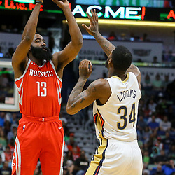 Mar 17, 2018; New Orleans, LA, USA; Houston Rockets guard James Harden (13) shoots over New Orleans Pelicans guard DeAndre Liggins (34) during the first quarter at the Smoothie King Center. Mandatory Credit: Derick E. Hingle-USA TODAY Sports