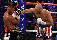 LAS VEGAS, NEVADA - JUNE 15:  Boxer Tyson Fury(R) hits Tom Schwarz during the second round at the MGM Grand Garden Arena on June 15, 2019 in Las Vegas, Nevada. Tyson Fury took the win by TKO after the fight was stop in the second round. (Photo by MB Media/Getty Images)