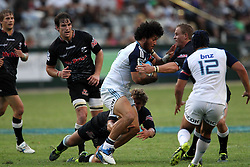 Patrick Lambie of The Sharks gets hold of Rene Ranger of The Blues during the Super15 match between The Mr Price Sharks and The Blues held at Mr Price Kings Park Stadium in Durban on the 26th February 2011..Photo By:  Ron Gaunt/SPORTZPICS