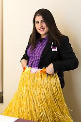 Assistant Manager Bruna Salvadori plays with a Hawaiian hula skirt. London, July 24 2019.