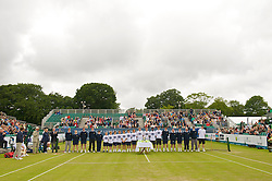 LIVERPOOL, ENGLAND - Saturday, June 20, 2009: The officials and ball boys line up fro the trophy presentation during the Men's Final on Day Four of the Tradition ICAP Liverpool International Tennis Tournament 2009 at Calderstones Park. (Pic by David Rawcliffe/Propaganda)