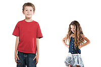 caucasian little boy posing and jealous girl portrait isolated studio on white background